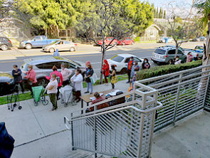 People lined up waiting for food at Bronson Court